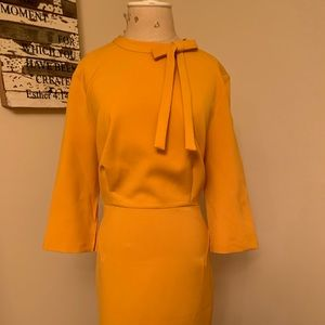 Lovely golden color work dress with tie.